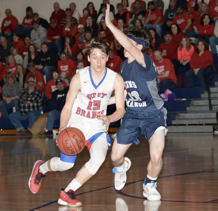 Trenton Bellomy playing on the basketball court against Penns Manor