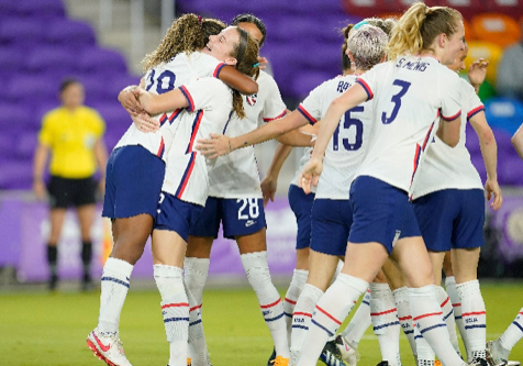 The USWNT hugs each other in celebration of Catarina Macario's first career international goal.