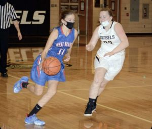 Jenna dribbles the ball down the court during the Lady Warriors win over Moshannon Valley.