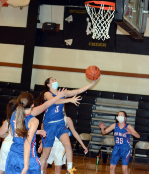 Photo caption: Sarah Betts goes in for a layup on Monday night's game against Moshannon Valley Damsels.