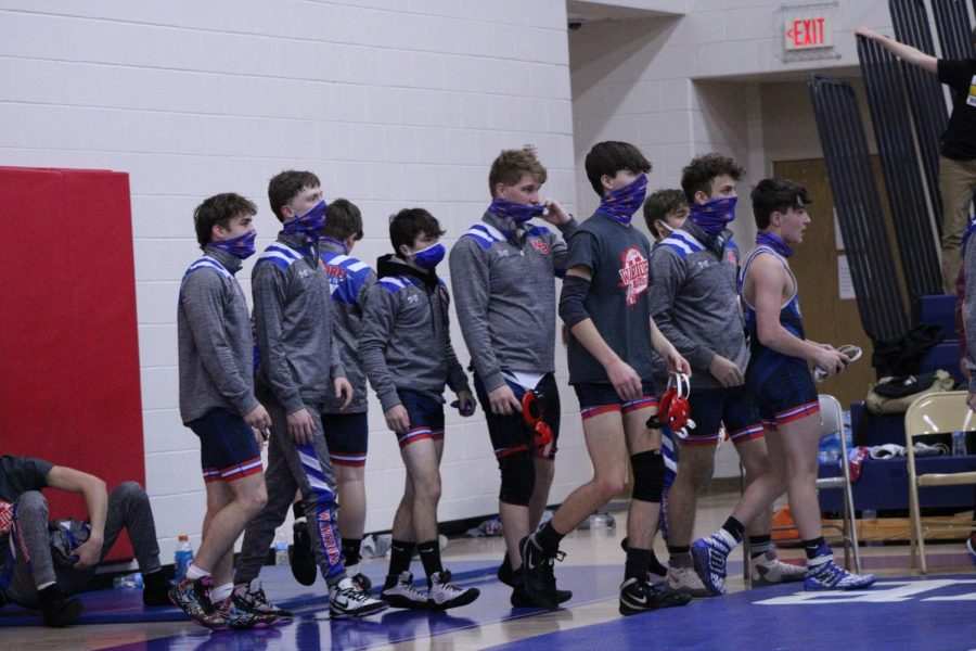 West Branch Wrestlers prepare to start by shaking hands with each other.