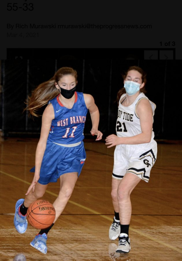 Jenna dribbles the ball down the court against Curwensville, where she scored a career-high 26 points.