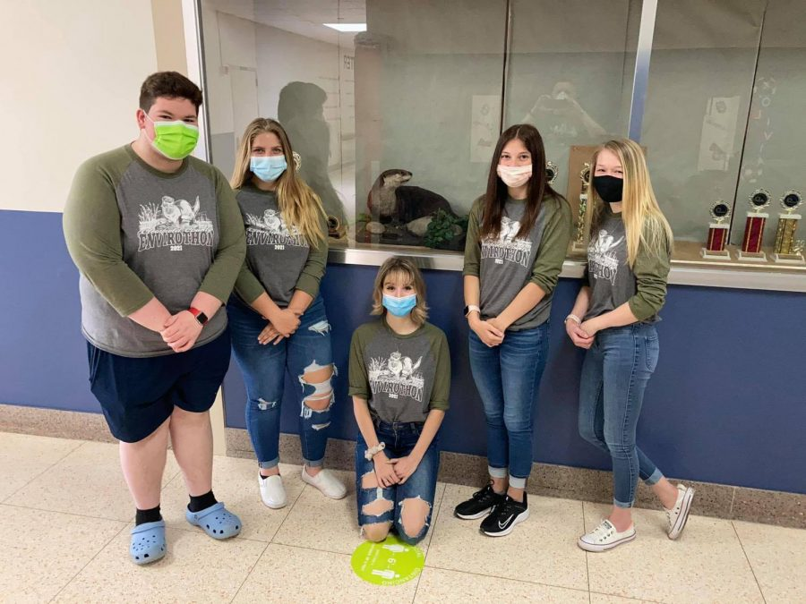 The team members of the envirothon team stand next to the otter which will remain at West Branch for another year after an impressive victory by the team.