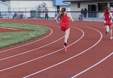 Freshman Jenna Mertz runs one of her events at her first track meet.