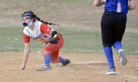 Sarah Betts stretches for a ball at first base to get an out for her team.