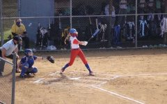 Meghan Cantolina finishing through a big swing at the opponents plate.