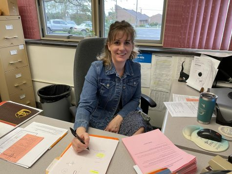 Mrs. Guenot at her desk getting ready to start the week.