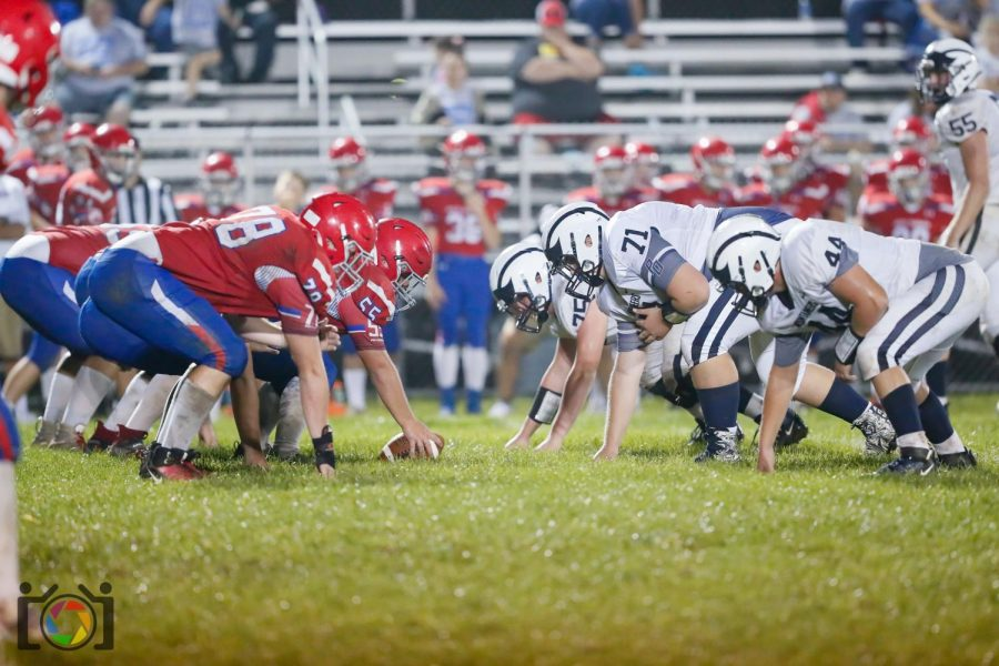 The West Branch Warriors and the Philipsburg-Osceola Mounties line up before a play.