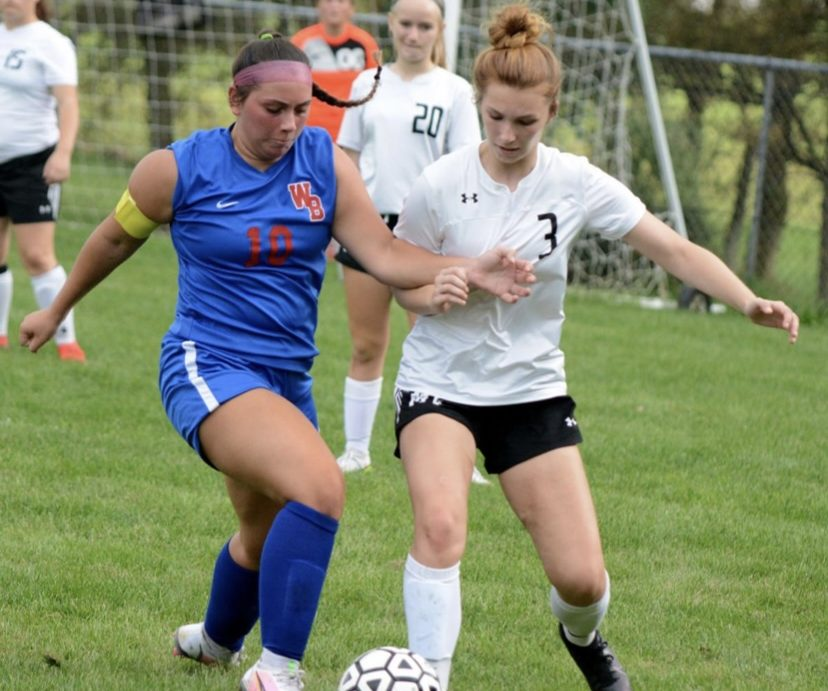 Straka getting the ball from defending player Sophia Demko of Mo-Valley.
