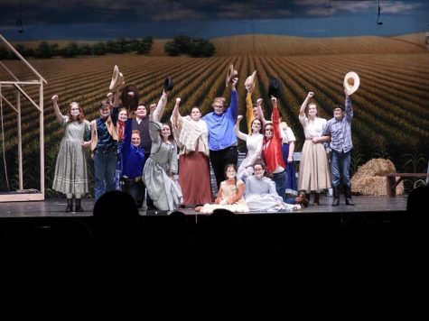 An action shot from the musical Oklahoma! performed by West Branch Performing Arts.