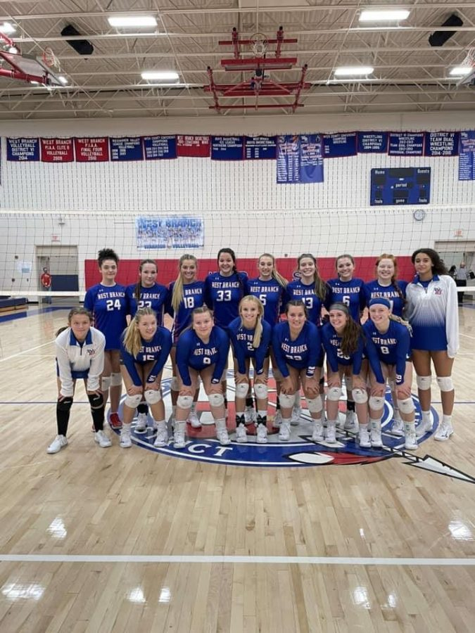 The Lady Warrior volleyball team after their win against Williamsburg.