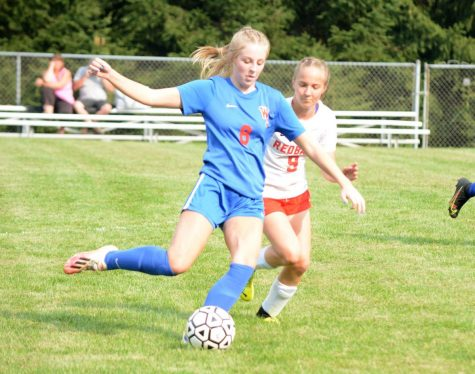 West Branch's Emily Parks takes a touch past Redbank Valley's Isabelle Faulk. Emily Parks scored the first goal for the Lady Warriors.