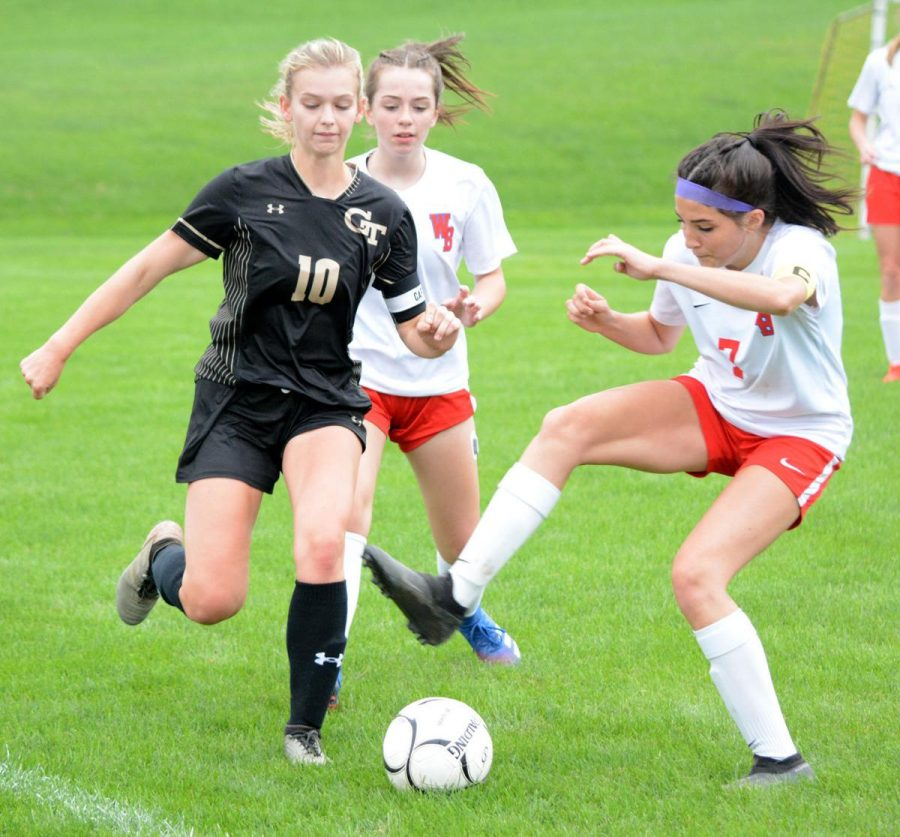Lady Warrior's Mariah Hayles drags the ball back as the Curwensville defense pressures her.