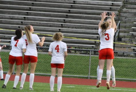 Lauren Timblin and Emily Parks jump to high five during the starting lineups prior to the game.