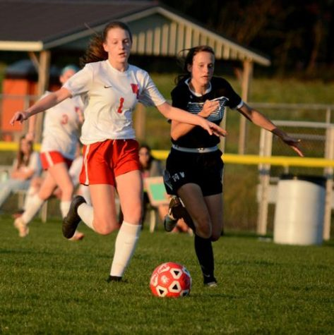 Guglielmi fends off an incoming defender from Moshannon Valley and wins the ball.